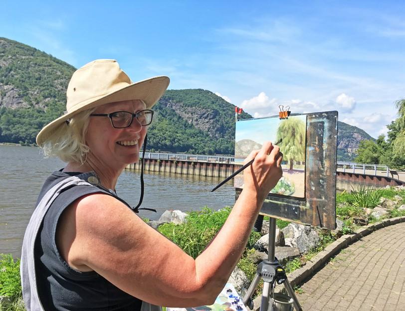 Susan Sapanara working her magic at the Cold Spring riverfront. Photo by Virginia Califano